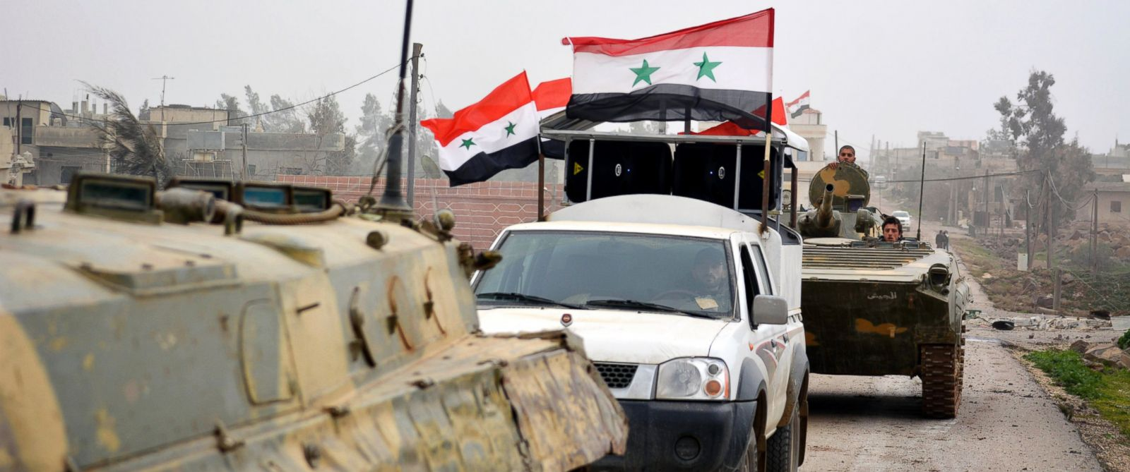 PHOTO: Fighters loyal to Syrias President Bashar Al-Assad ride on military vehicles and tanks after regaining control of Deir al-Adas, a town south of Damascus, on Feb. 10, 2015.