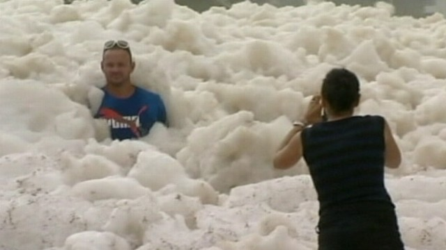 VIDEO: Remnants of a tropical cyclone create froth along Australias Sunshine Coast.