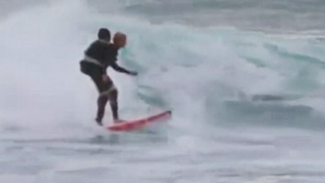 VIDEO: A 50-year-old woman in Australia was taped to a surfers back in order to realize her dream.