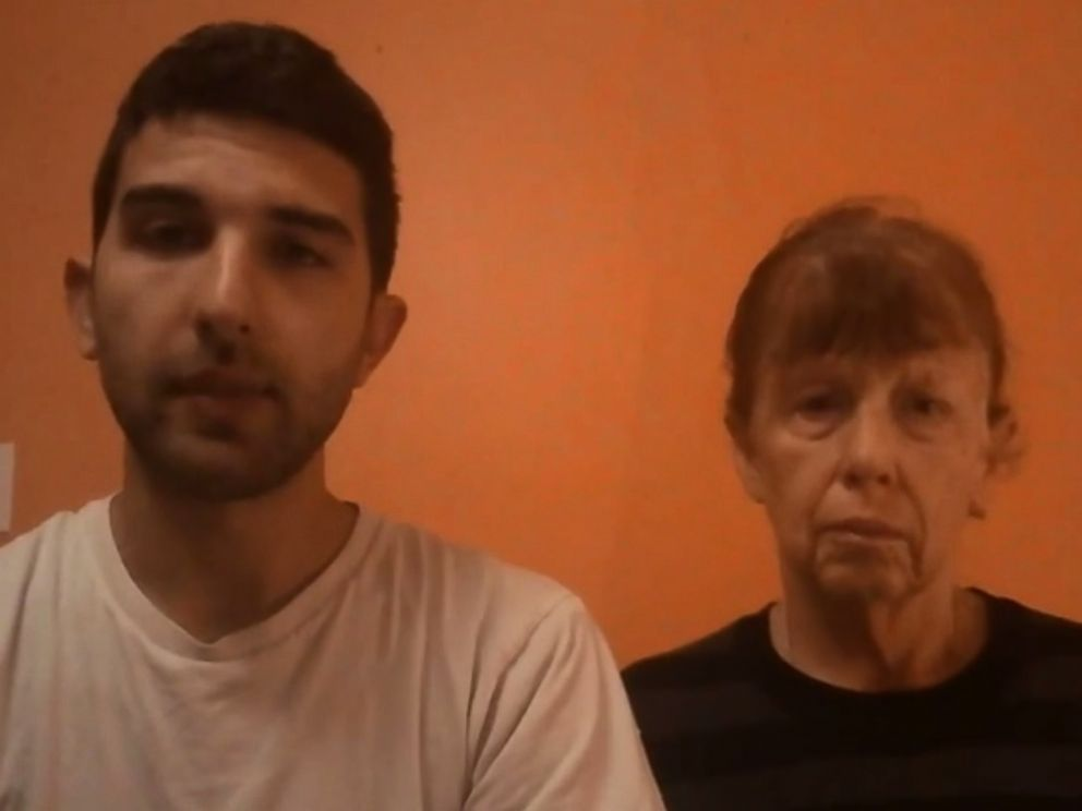 PHOTO: Al Qaeda hostage Luke Somers brother Jordan, left, and mother Paula, right, plead with the militants holding Luke in video posted online Dec. 4, 2014.