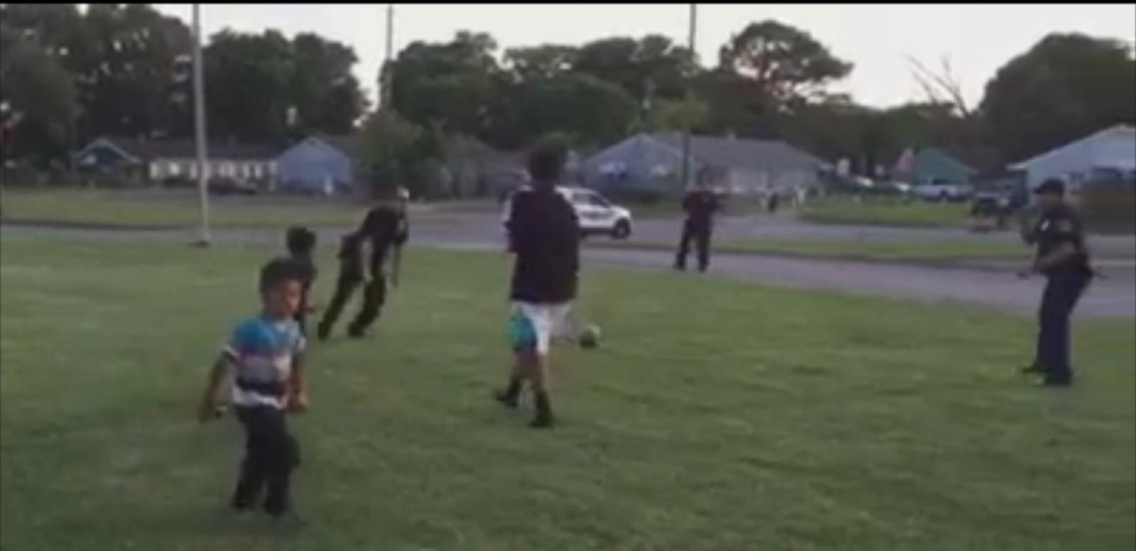 The Birmingham, Alabama, officers started a game of soccer with kids playing in a parking lot.