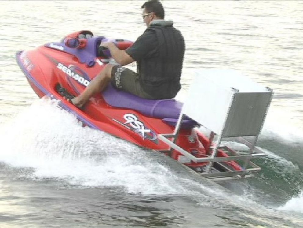 PHOTO: Nick Ferrugia, Long Lake Grocery owner, wears a life jacket to deliver pizzas on his jet ski in this frame grab from an undated video.