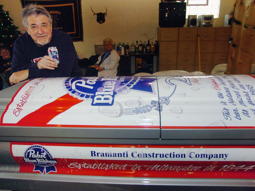 PHOTO: In this file photo, Bill Bramanti poses with a coffin he had specially designed to look like a can of his favorite beer, Pabst Blue Ribbon, in Chicago Heights, Ill on May 3, 2008.
