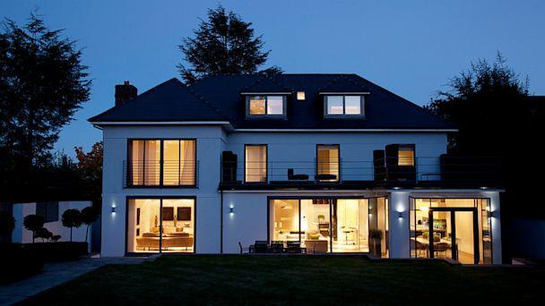 PHOTO: Modern house illuminated at night.
