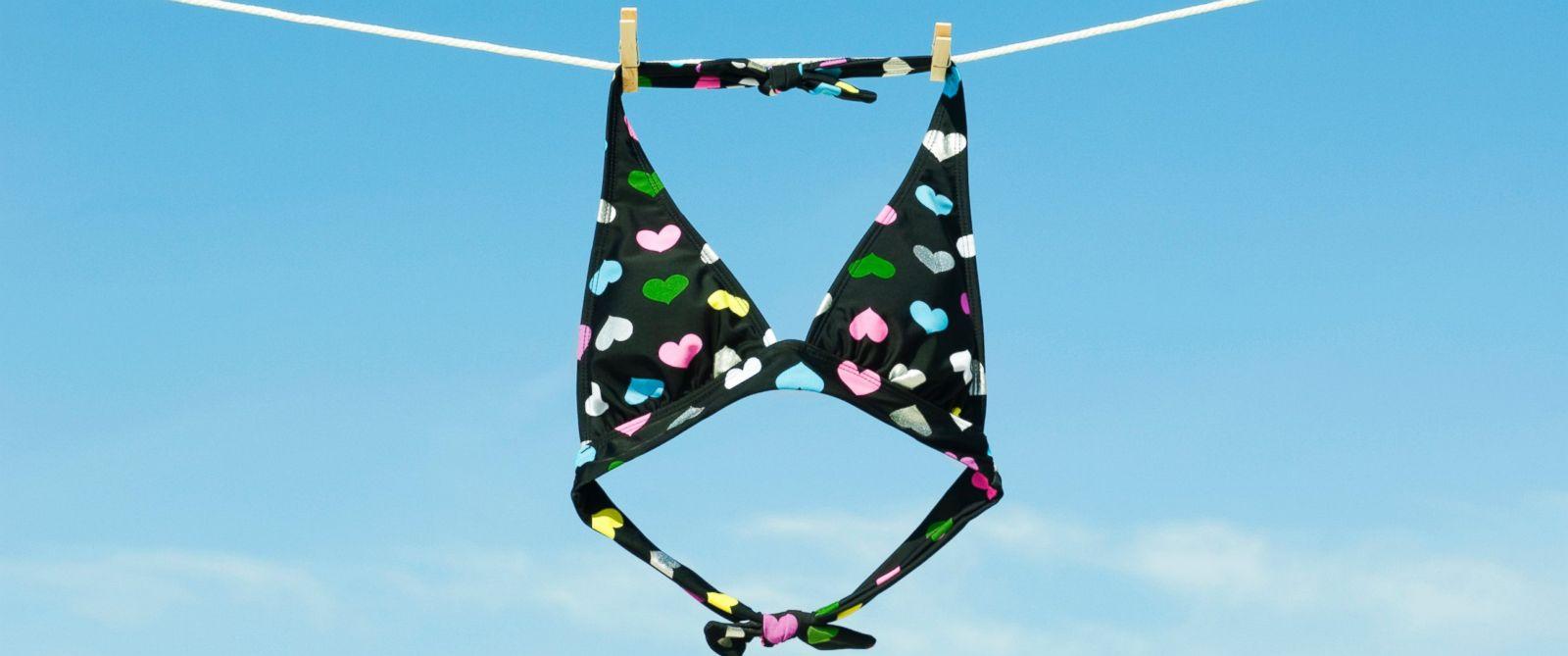 PHOTO: A bikini top hangs on a clothesline.