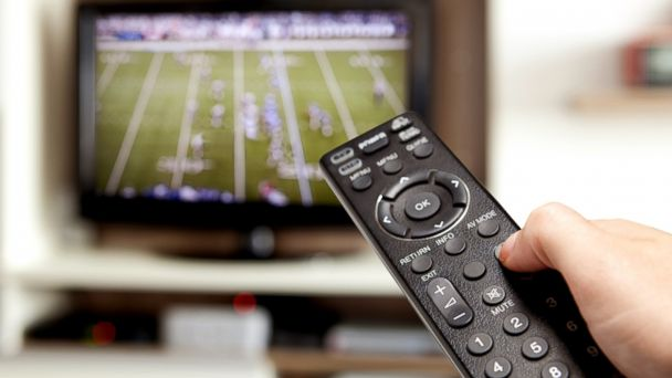 PHOTO: Changing the channel during a football game.