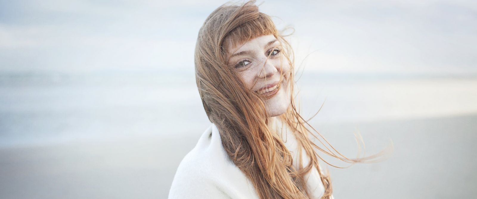 PHOTO: In this stock image, a woman with windswept hair is pictured.