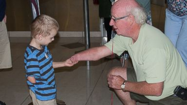 PHOTO:Kirill Facey is pictured meeting his grandfather Chris Facey.