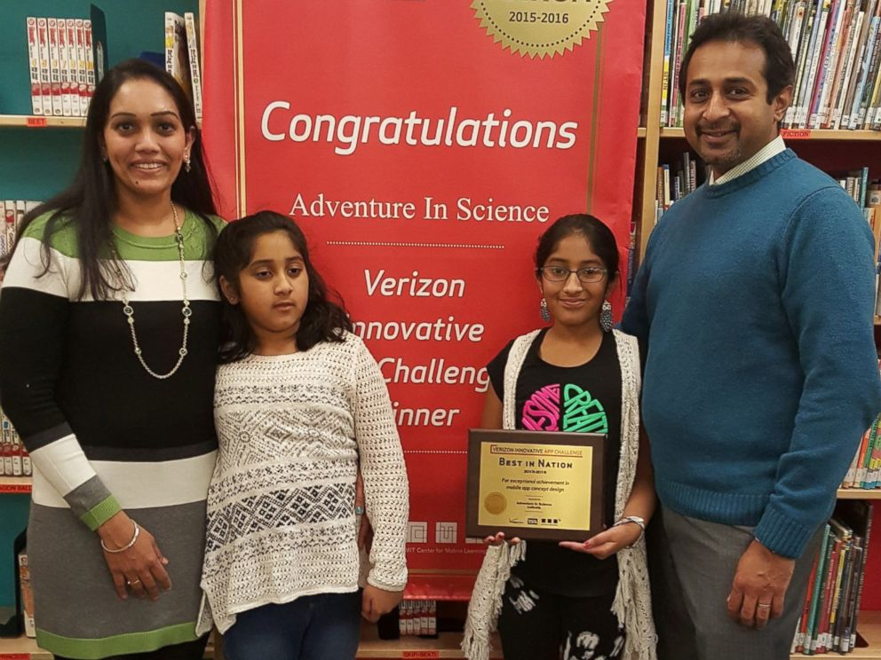 PHOTO: Eashana, 12, and Meghana Subramanian, 9, with their parents after AutBuddy won the 2016 Verizon App Challenge.