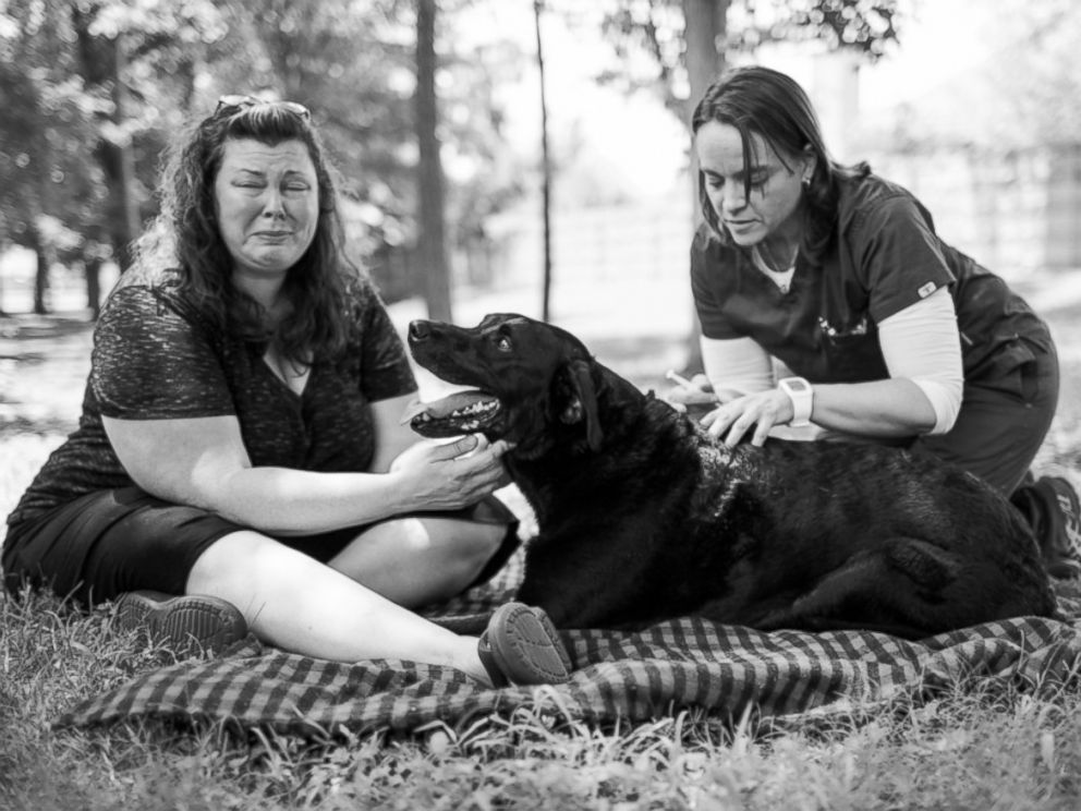 PHOTO: Jordan Greene Roberts sits beside her dog, Duke, at the end of his final day.