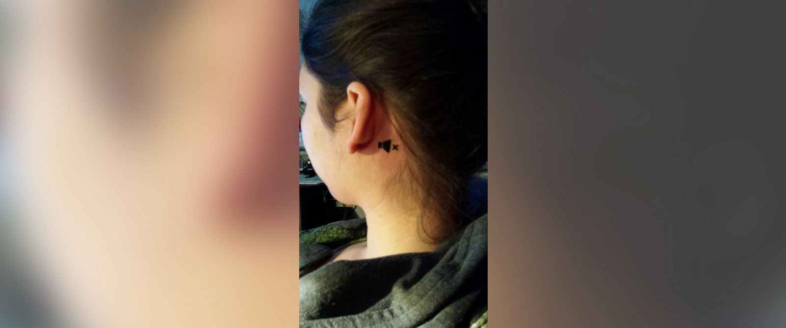 PHOTO: Elisa Menzels tattoo behind her left ear, telling strangers shes deaf in one ear, has gone viral.