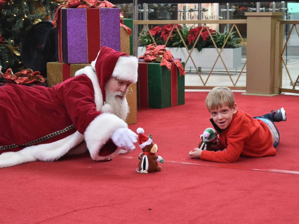 PHOTO: Brayden Deely, 6, took awhile to warm up to Santa so Santa got on the floor with him.