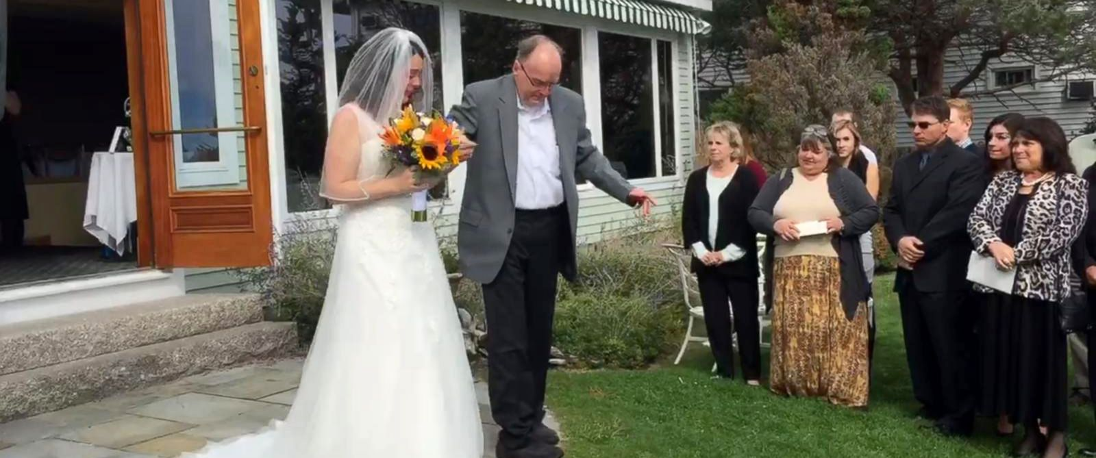PHOTO: Ralph Duquette surprised his daughter Heather by standing up from his wheelchair and walking her down the aisle at her wedding in Maine.