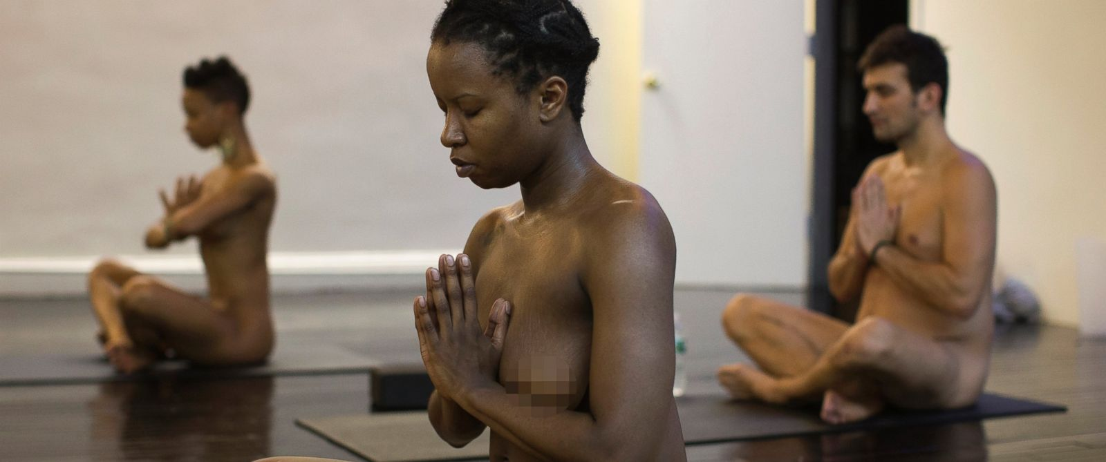PHOTO: Vanessa Kennedy assumes a position during the Bold & Naked yoga class in New York March 19, 2014.