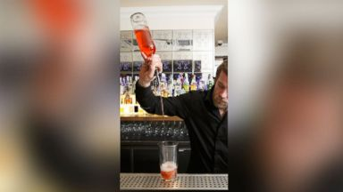 "PHOTO: A ""long pour"" by a bartender."