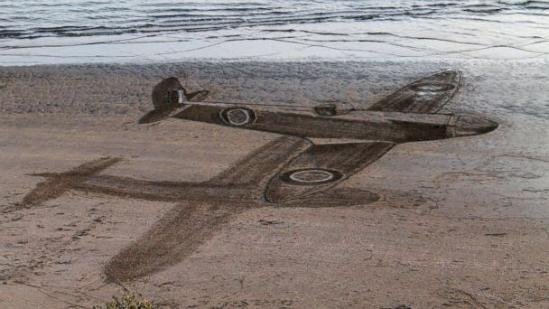 PHOTO: Artist James Harkins uses sand as a canvas to create his works of art.