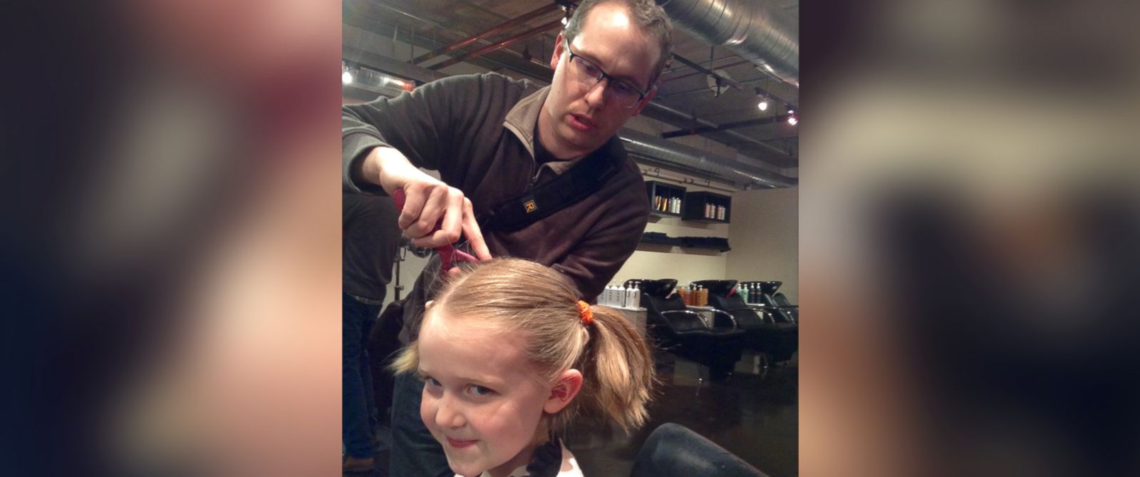 """PHOTO: Denver salon Envogue offers a """"beer and braids"""" class so dads can learn how to style their daughters hair."""