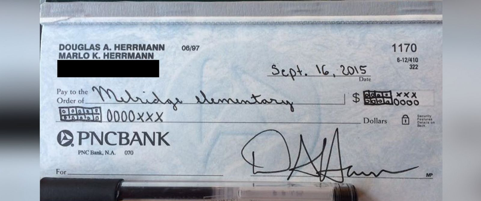 PHOTO: Doug Herrmann wrote a check to his sons school using the common core teaching strategy.