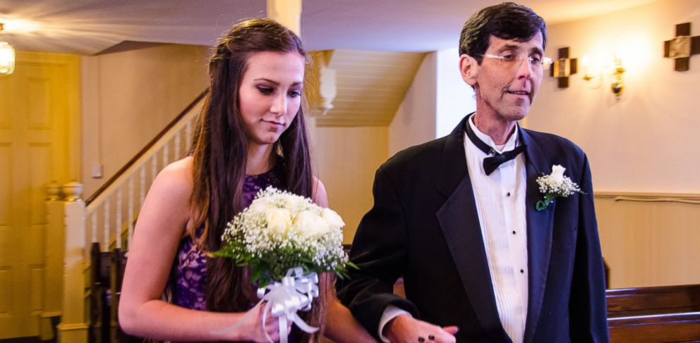 PHOTO: Ken McHugh, 47, fulfilled his dying wish to walk his four children down the aisle on October 3.