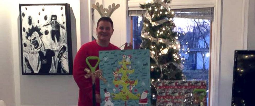 PHOTO: Dodd surrounded by the gifts he will deliver to one family in need.