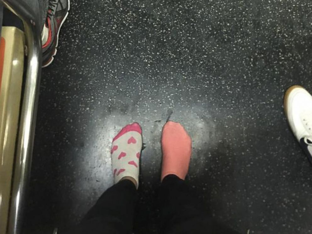 PHOTO: Kay Brown stands on a subway train in her socks, Nov. 16, 2015, after giving her shoes to a homeless woman.