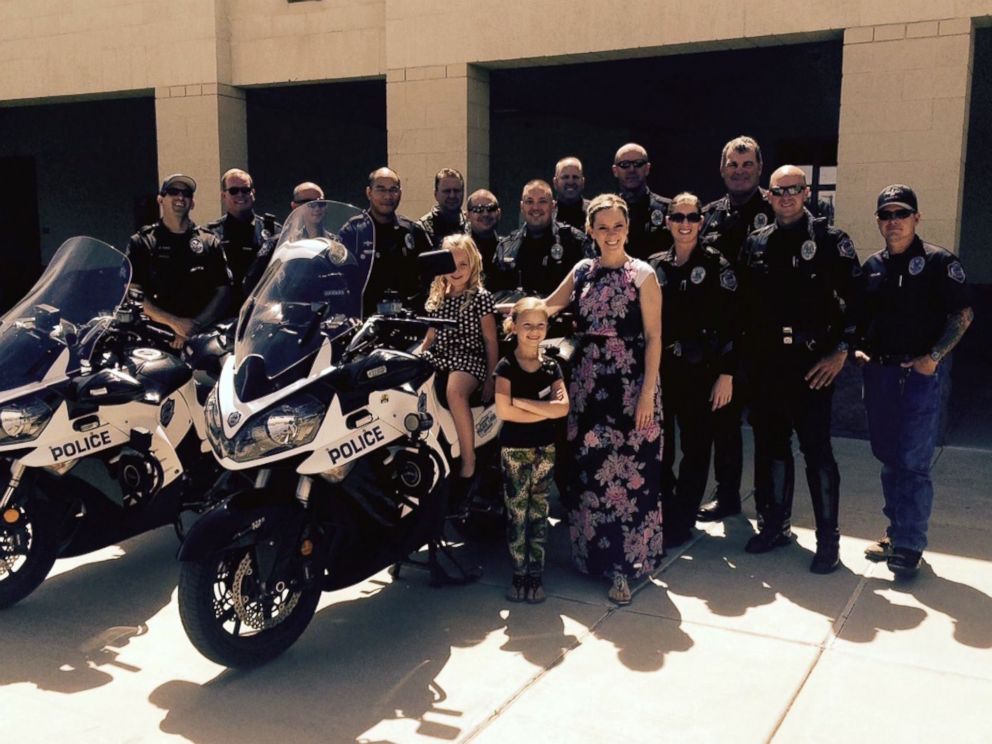 PHOTO: Sophia Prinkey and her family pose with members of the Mesa Police Department.