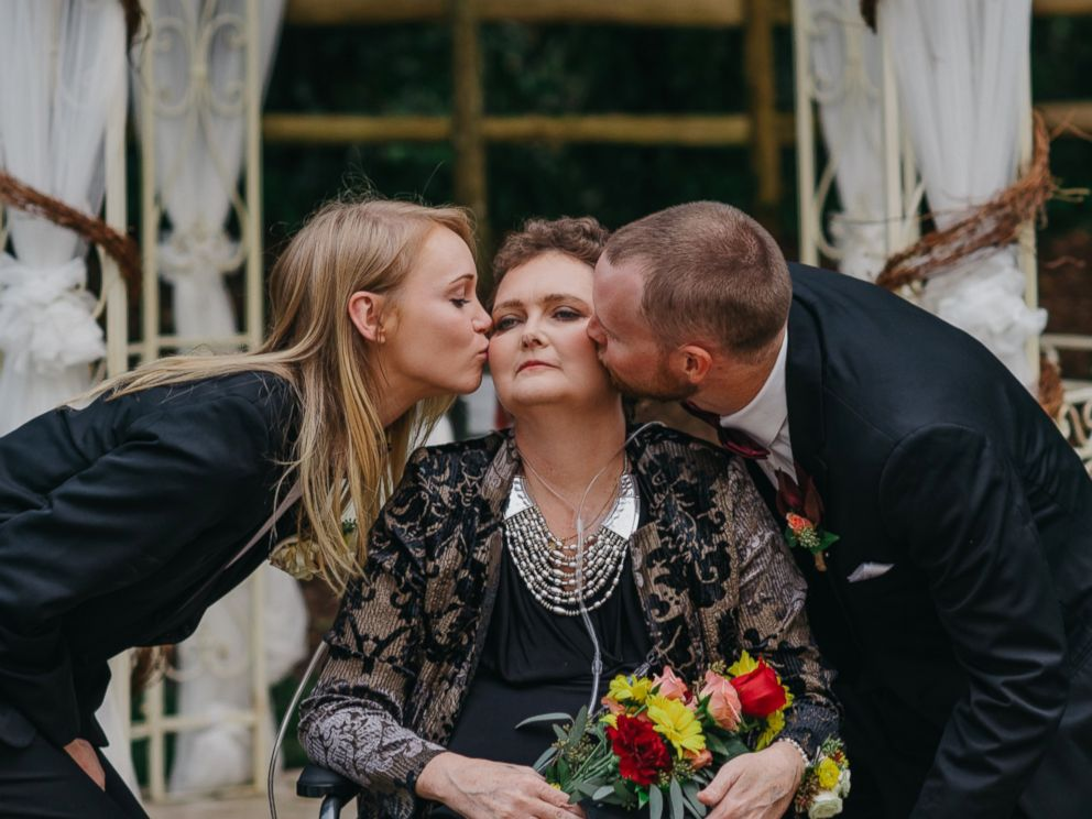PHOTO: Tory and Tyler Crosby kissing their mother Dot on Tylers wedding day.