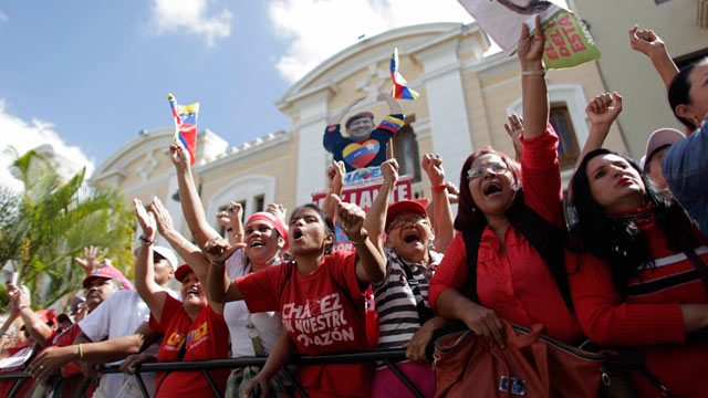 PHOTO: Supporters of Venezuelas President Hugo Chavez chant slogans outside the National Assembly in Caracas, Venezuela, Jan. 5, 2013.