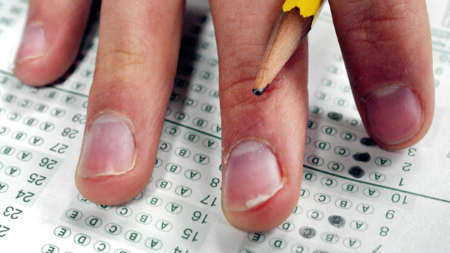 PHOTO: A student pauses while taking a sample SAT test during his prep class in Newton, Massachusetts in this March 3, 2005 file photo.
