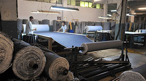 PHOTO: This picture taken on May 14, 2010, shows Pakistani employees work at a textile factory in Karachi.