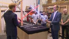 Dueling Royals: Princes William and Harry Spar with Lightsabers