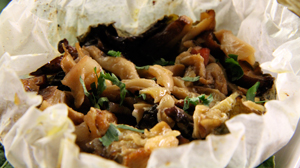 PHOTO Mixiotes of Woodland Mushrooms with Slow-Cook Garlic and Mexican Herbs are shown.