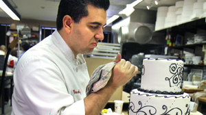 """PHOTO Buddy Valastro of TLC?s """"Cake Boss"""" puts the finishes touches on his latest confectionary creation."""