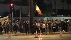 VIDEO: Police say about 20 people were arrested outside the California rally.