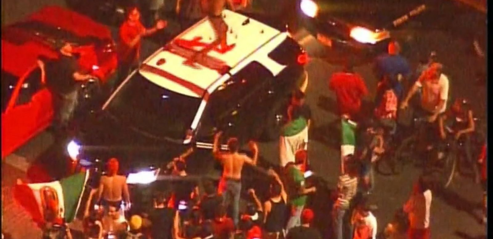 VIDEO: A protester was arrested after a chaotic scene erupted outside a Donald Trump rally in New Mexico overnight, which left several officers injured after being pelted by rocks.