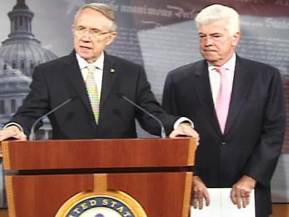 pic of senator reid and senator dodd discussing the bailout bill