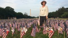 PHOTO: Mary Alice Horrigan honors the memory of those who served and sacrificed by planting flags on the National Mall for Memorial Day.