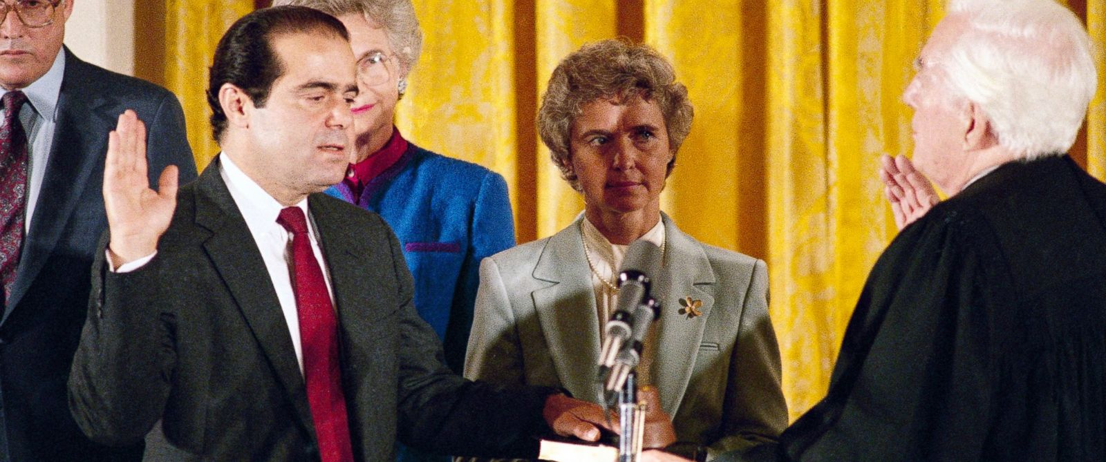 PHOTO: In this Sept. 26, 1986 file photo, retiring Chief Justice Warren Burger, right, administers an oath to Associate Justice Antonin Scalia, as Scalias wife, Maureen, holds the bible during ceremonies in the East Room of White House, Washington.