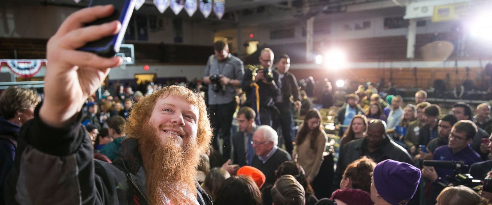 PHOTO: Joshua Sears, of Waterloo, takes a selfie with Democratic presidential candidate Sen. Bernie Sanders in the background after an event at the University of Northern Iowa, in Cedar Falls, Iowa, Jan. 24, 2016.