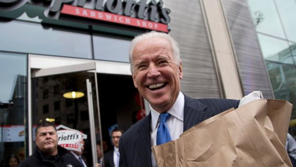 PHOTO: Vice President Joe Biden carries a bag full of food as he talks with reporters outside Capriottis Sandwich Shop in Washington, Nov. 21, 2013.