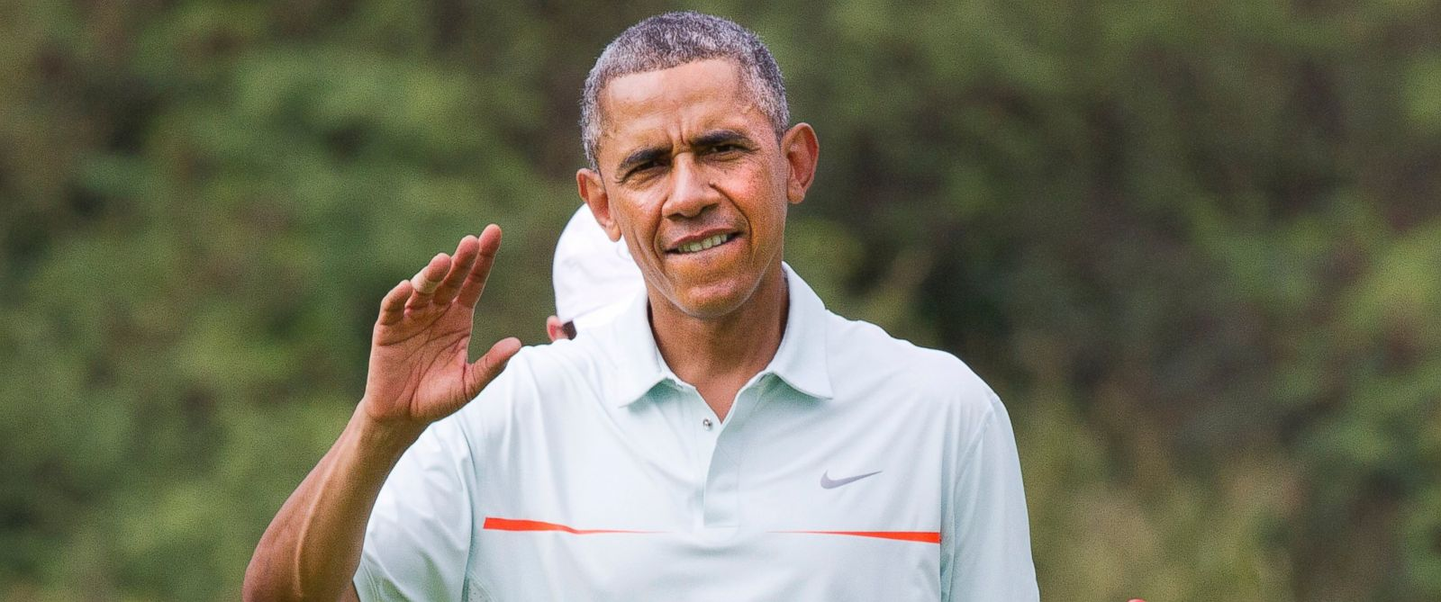 President Obama waves to the traveling press as he plays golf with Malaysian Prime Minister Najib Razak Wednesday, Dec. 24, 2014, at Marine Corps Base Hawaiis Kaneohe Klipper Golf Course in Kaneohe, Hawaii, during the Obama family vacation.