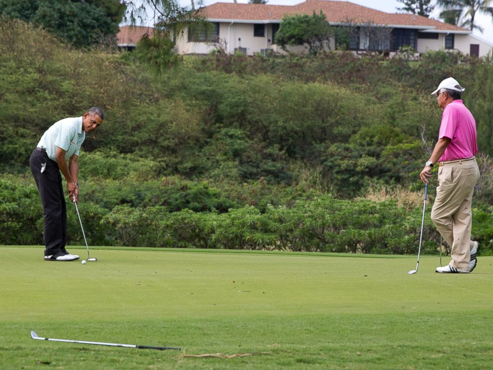 President Barack Obama plays golf with Malaysian Prime Minister Najib Razak, right, Wednesday, Dec. 24, 2014, at Marine Corps Base Hawaiis Kaneohe Klipper Golf Course in Kaneohe, Hawaii during the Obama family vacation.