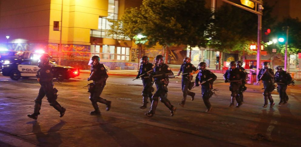 PHOTO: Riot police respond to anti-Trump protests following a rally and speech by Republican presidential candidate Donald Trump, in front of the Albuquerque Convention Center where the event was held, in Albuquerque, N.M., Tuesday, May 24, 2016.