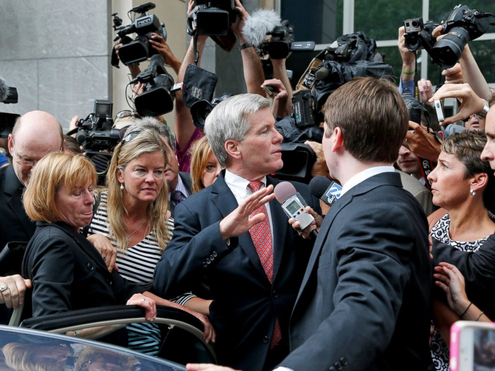 PHOTO: Former Virginia Gov. Bob McDonnell, center, is mobbed by media as he gets into a car with his son after he and his wife were convicted on multiple counts of corruption at Federal Court in Richmond, Va., Sept. 4, 2014.