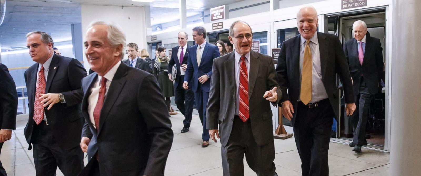 PHOTO: Senators rush to the floor for a procedural vote to advance the $585 billion defense bill at the Capitol in Washington, Dec. 11, 2014.