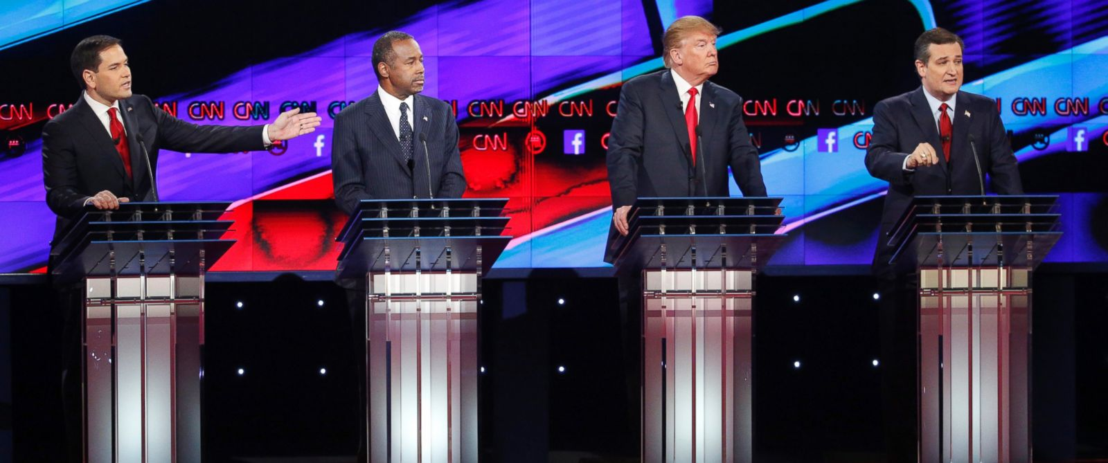 PHOTO: Marco Rubio, left, and Ted Cruz, right, both speak as Ben Carson, second from left, and Donald Trump, second from right, look on during the CNN Republican presidential debate at the Venetian Hotel & Casino, Dec. 15, 2015, in Las Vegas.
