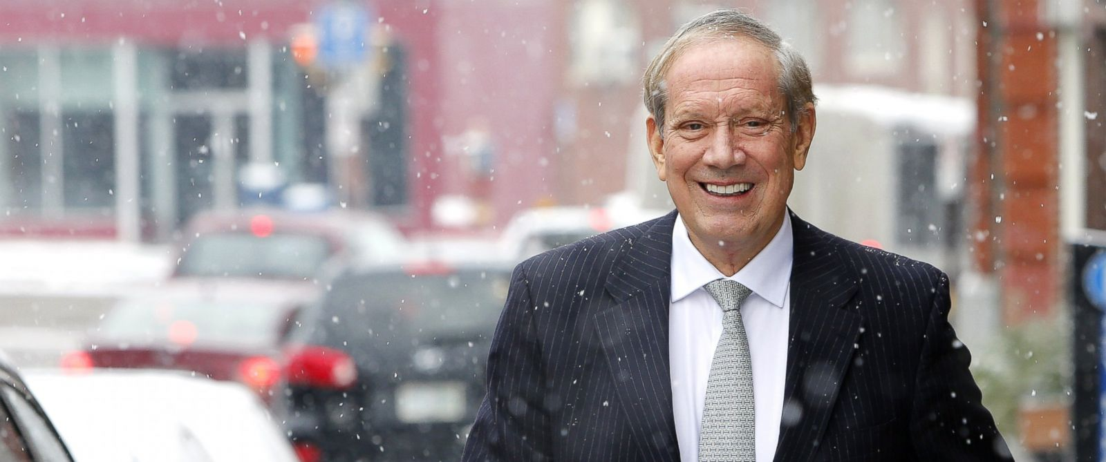 PHOTO: Former New York Republican Gov. George Pataki walks through the snow Monday, Jan. 12, 2015, in Concord, N.H.