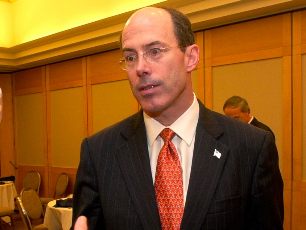 PHOTO: Joseph E. Schmitz, Inspector General of the U.S. Department of Defense, listens to criticism after speaking at the Cleveland City Club, in Cleveland, June 25, 2004.