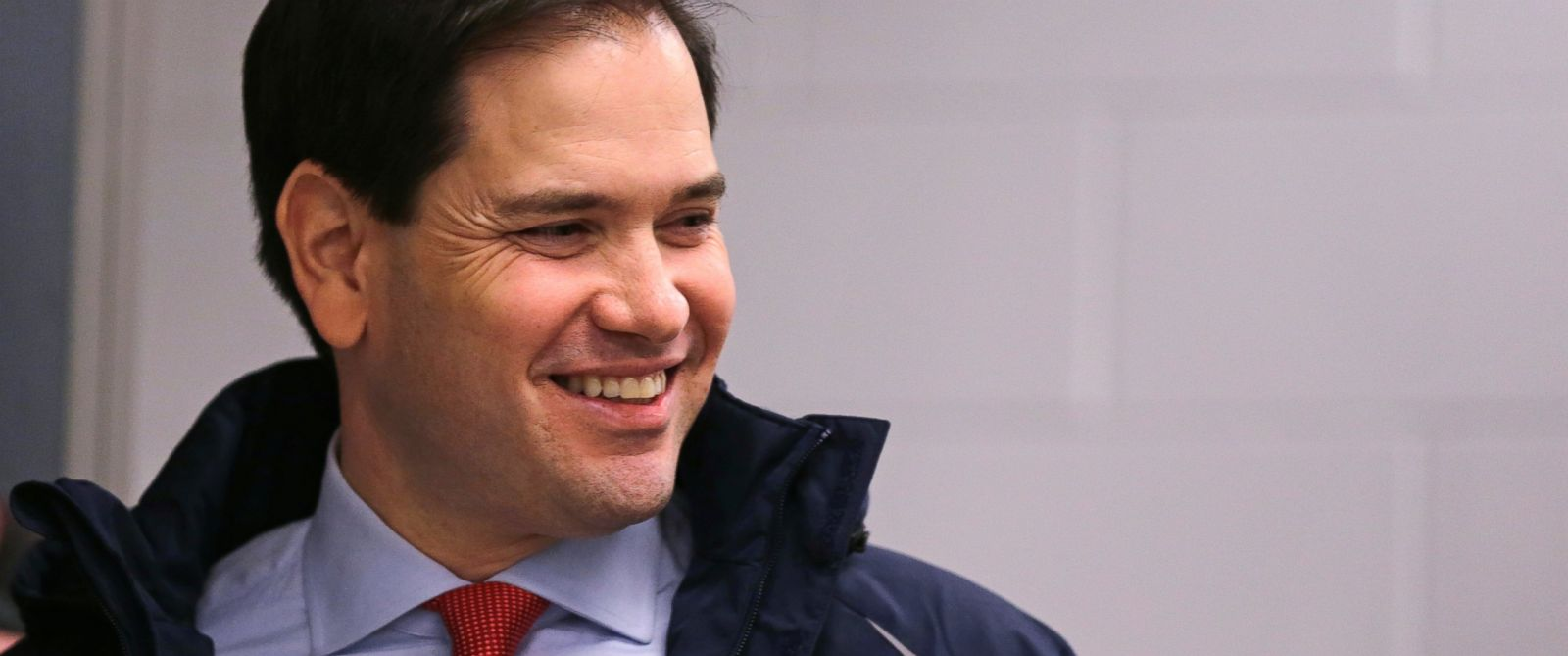 PHOTO: Republican presidential candidate, Sen. Marco Rubio, R-Fla. smiles as he arrives for a campaign stop at a welding company in Brookline, N.H., Jan. 21, 2016.