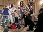 PHOTO: First lady Michelle Obama reacts as Ashtyn Gardner, 2, from Mobile, Ala., loses her balance when she was greeting Sunny, one of the presidential dogs at the White House in Washington, Dec. 4, 2013.